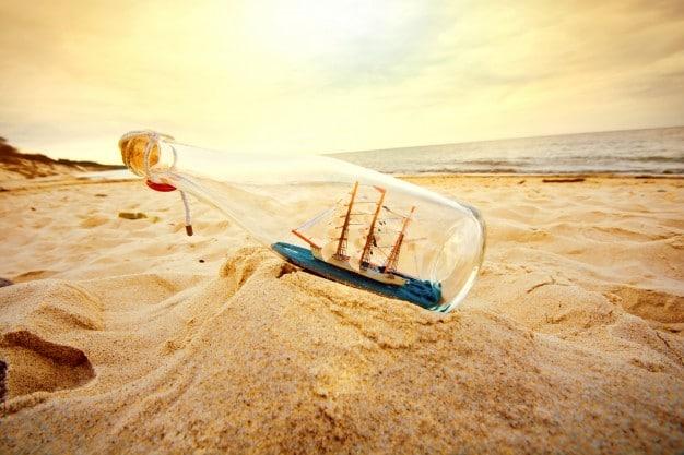 A sailing ship inside a glass bottle on an Australian beach